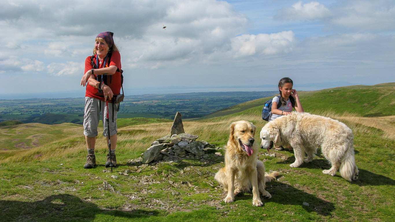 Summit cairn Low Fell with Ann Hiley, Mila, and the Hileys dogs, Dylan and Harry
